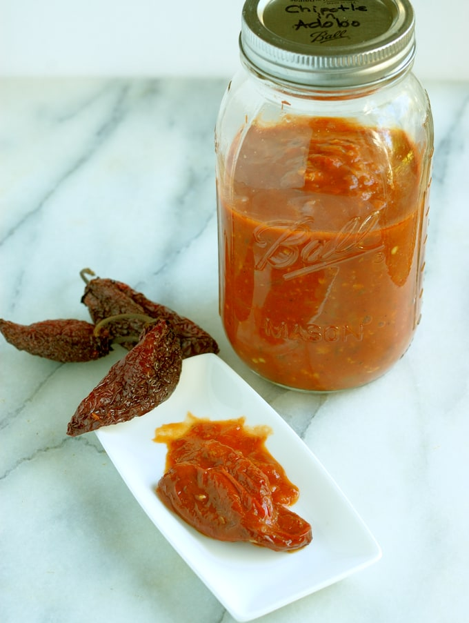 a plaste of chipotles in adobo and a jar of homemade sauce