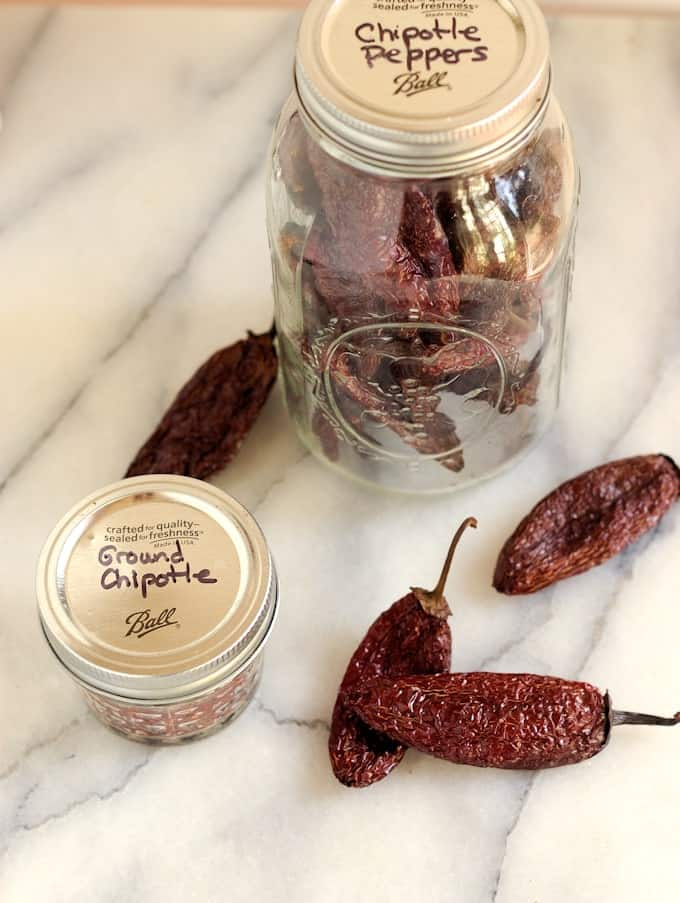 two jars of homemade chipotle peppers