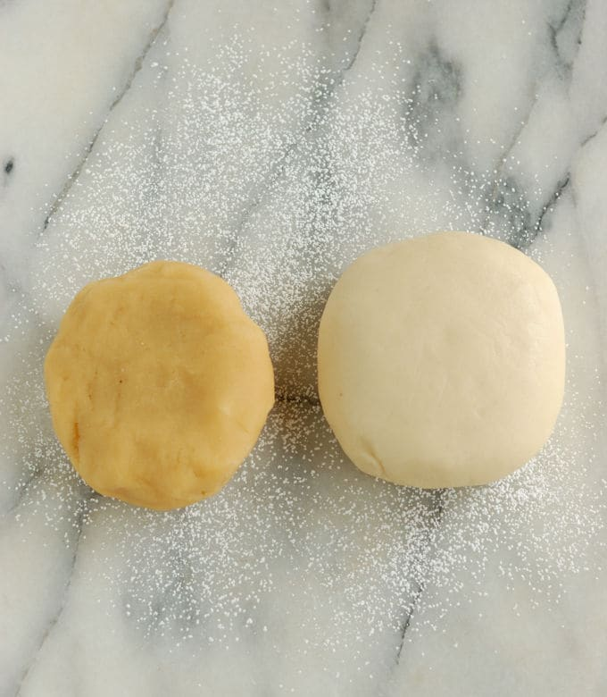 a piece of almond paste and a piece of homemade marzipan