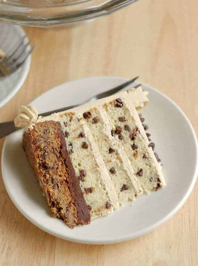 a slice of chocolate chip cookie cake on a white plate