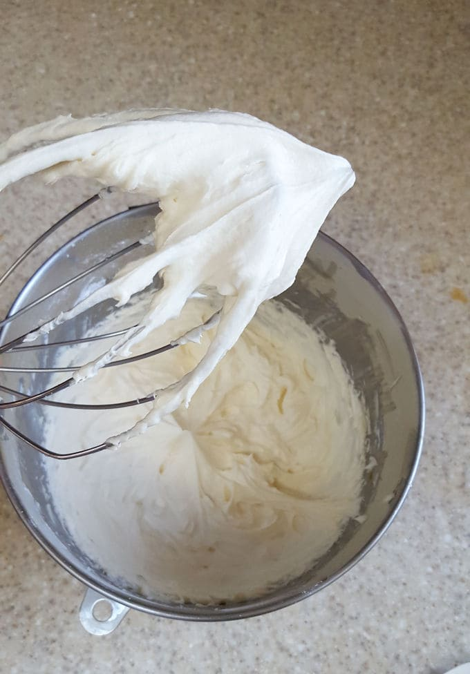 whipped cream frosting on a whisk