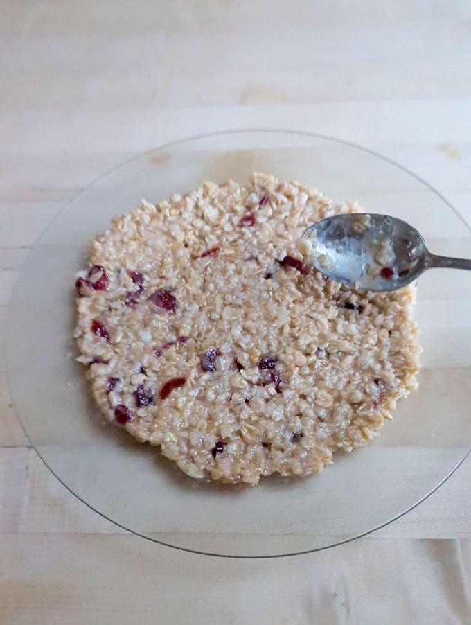 showing how to flatten oatmeal into a pancake shape