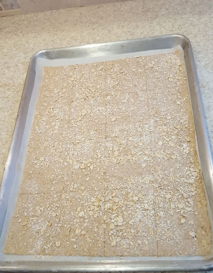 a tray of oatmeal crispbread ready for the oven