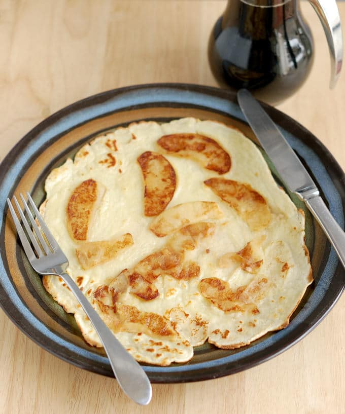 a Sweet Dutch Pancake with sauteed cinnamon apples on top.