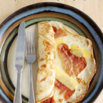 a pinterest image of a savory dutch pancake, pannekoeken