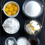 cake ingredients on a black background