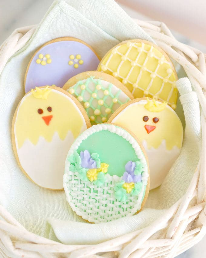 a basket of decorated sugar cookies for easter