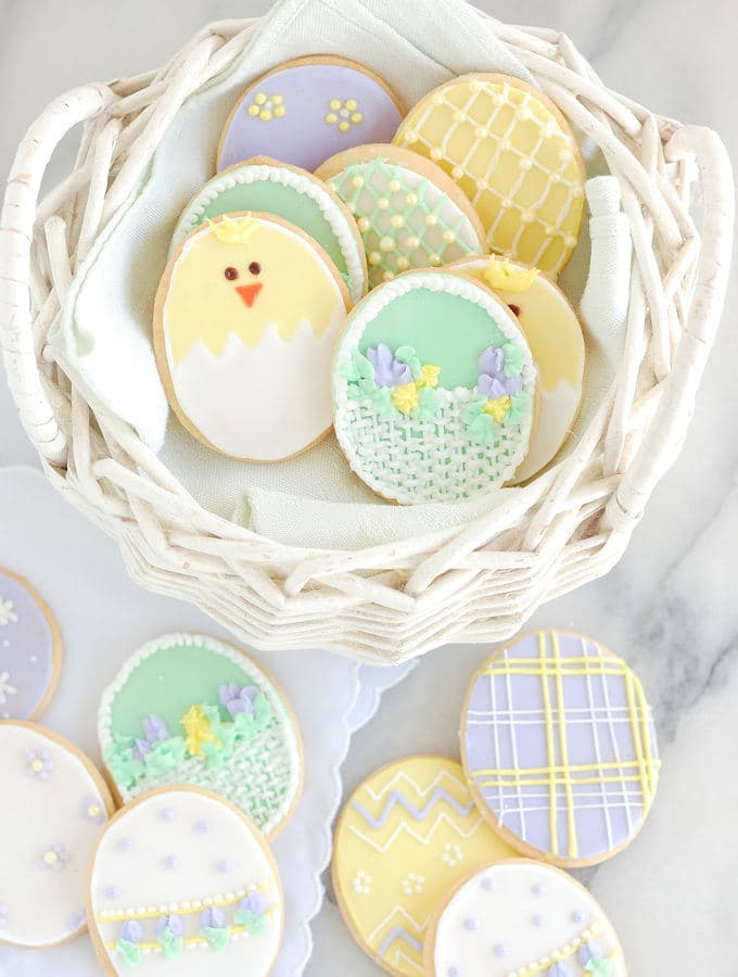 a basket of decorated sugar cookie for easter