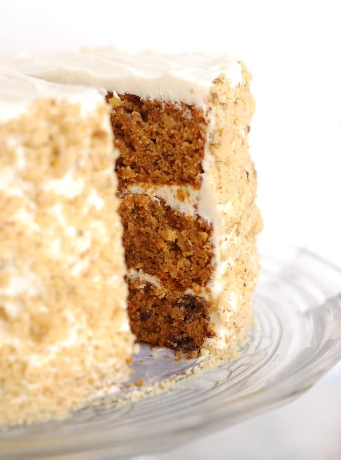 a sliced carrot cake on a cake stand
