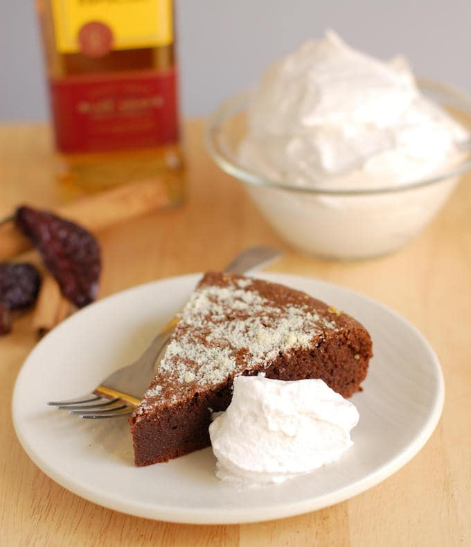 a slice of flourless mexican hot chocolate cake with cream