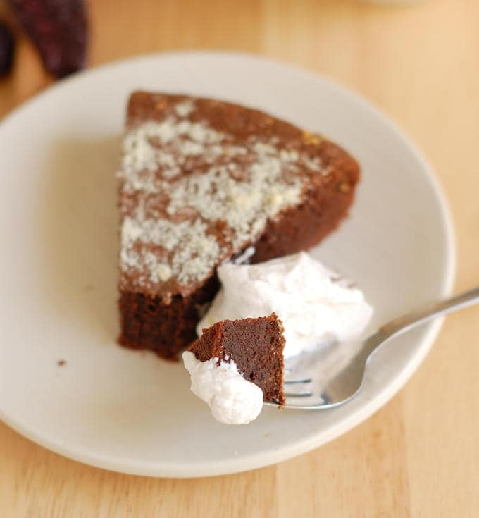 a slice of flourless mexican hot chocolate cake with a fork