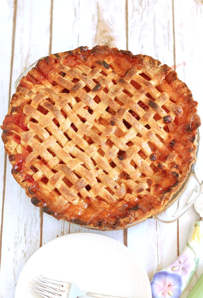 an apricot raspberry pie with lattice crust