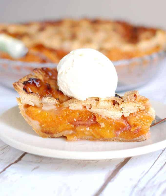 a slice of apricot raspberry pie on a plate