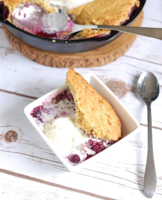 blueberry cornbread cobbler with vanilla ice cream