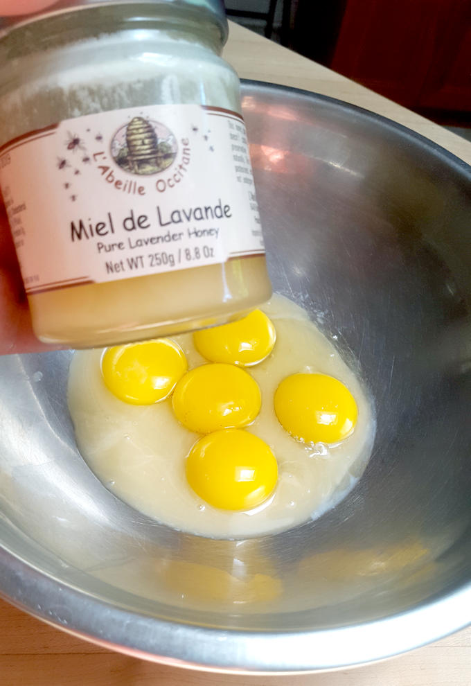 lavender honey and egg yolks in a bowl