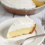 a slice of margarita pie on a white plate with a fork