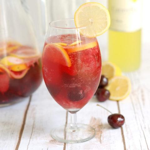 a glass of pink lemonade sangria