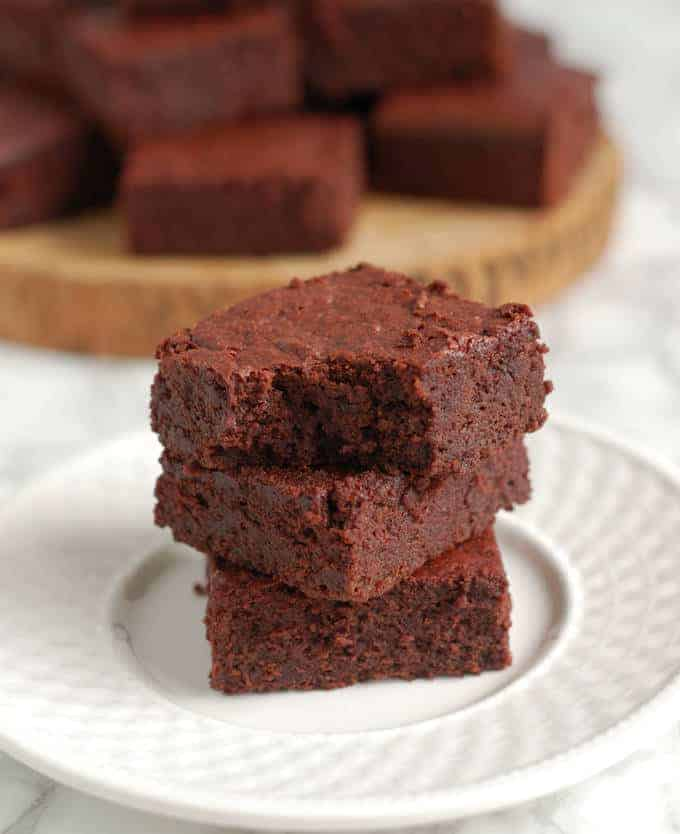a stack of roasted beet brownies, one with a bite