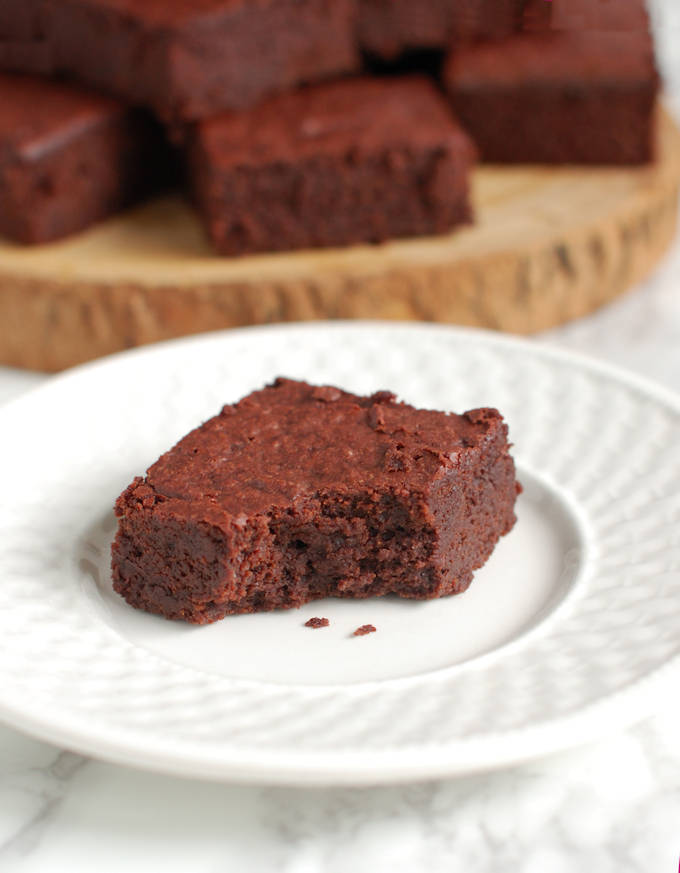 a beet brownie on a plate with a bite taken