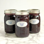 three jars of homemade Concord Grape Jam