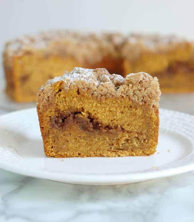 a slice pumpkin coffee cake on a plate