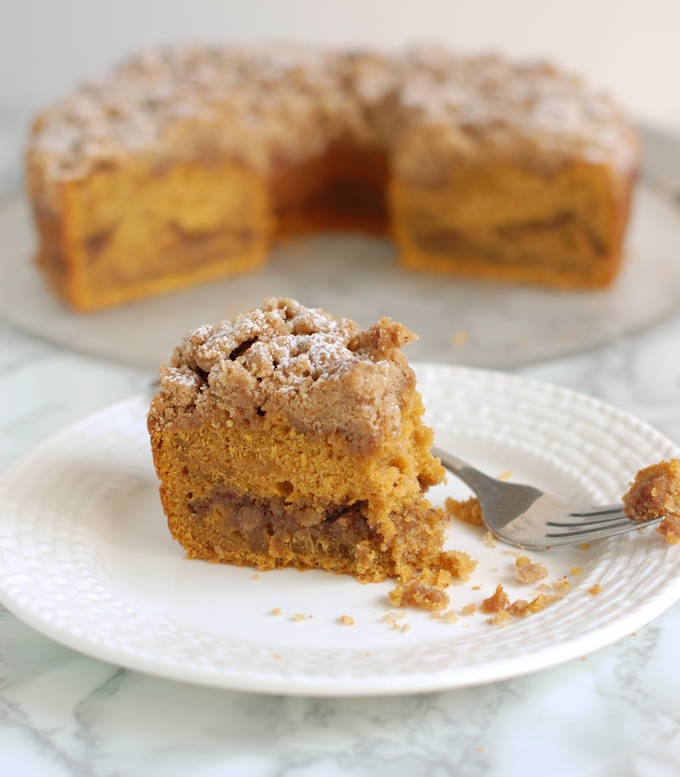a partially eaten slice of pumpkin coffee cake on a plate