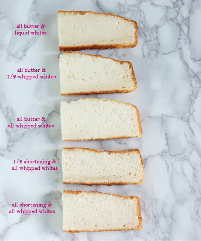 Five slices of white cake from various test cakes showing the difference in texture.