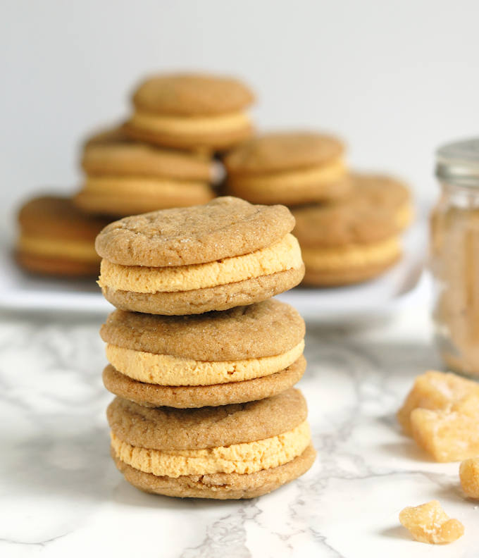 a stack of ginger sandwich cookies with pumpkin ganache filling