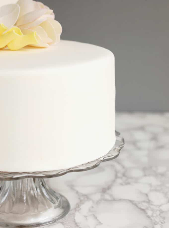 a closeup shot of a cake covered with rolled fondant