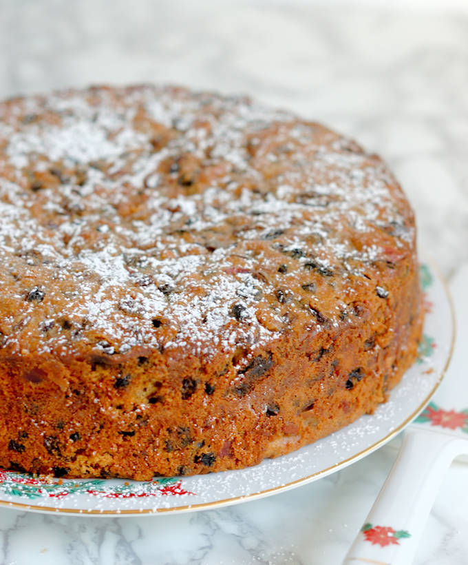 a brandy aged fruitcake with no icing on a plate