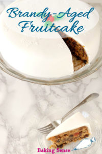 a pinterest image of a brandy aged fruitcake with text overlay
