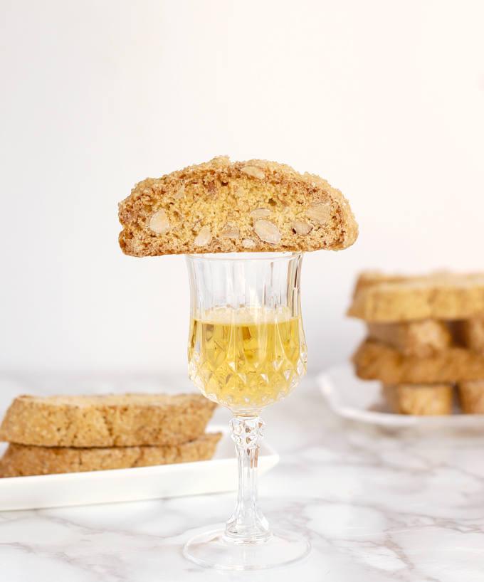 A Biscotti cookie on a glass of dessert wine