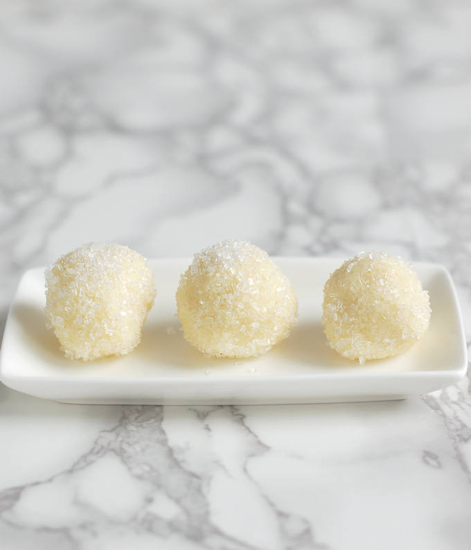 white chocolate ganache snowball truffles on a plate