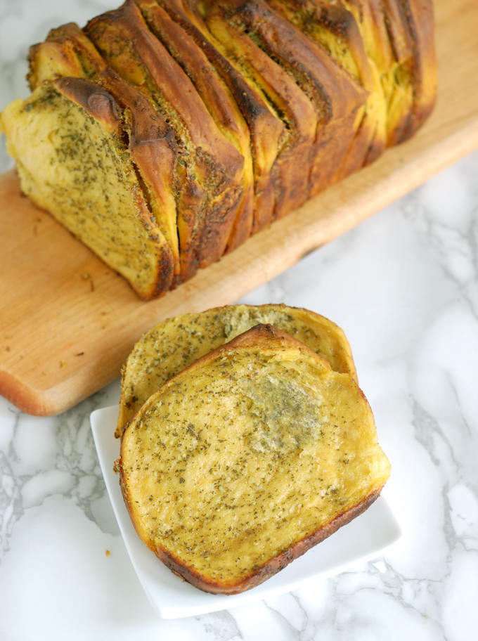 two slices of pumpkin pull apart bread on a plate