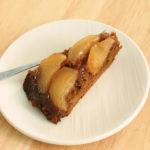 a slice of Pear Gingerbread upside down cake on a plate