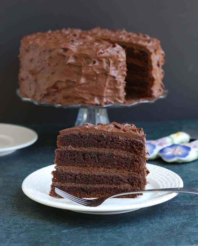 a slice of old fashioned chocolate cake on a plate
