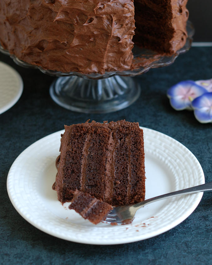 a slice of old fashioned chocolate cake on a plate with a fork
