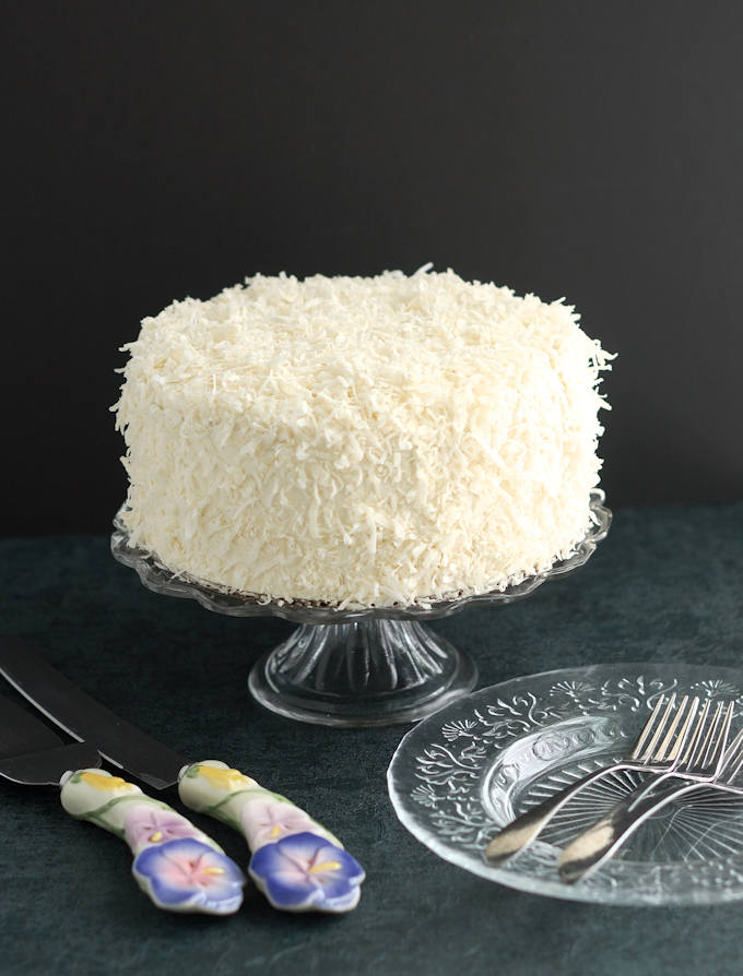 a Snow White Coconut Layer Cake against a black background