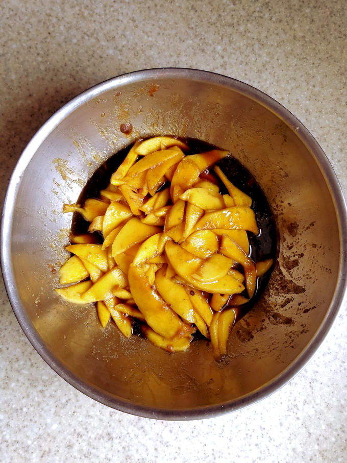 macerating mangos in a bowl