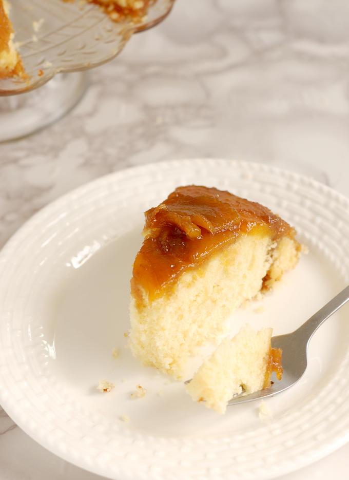 a partially eaten slice of Mango Upside Down Cake