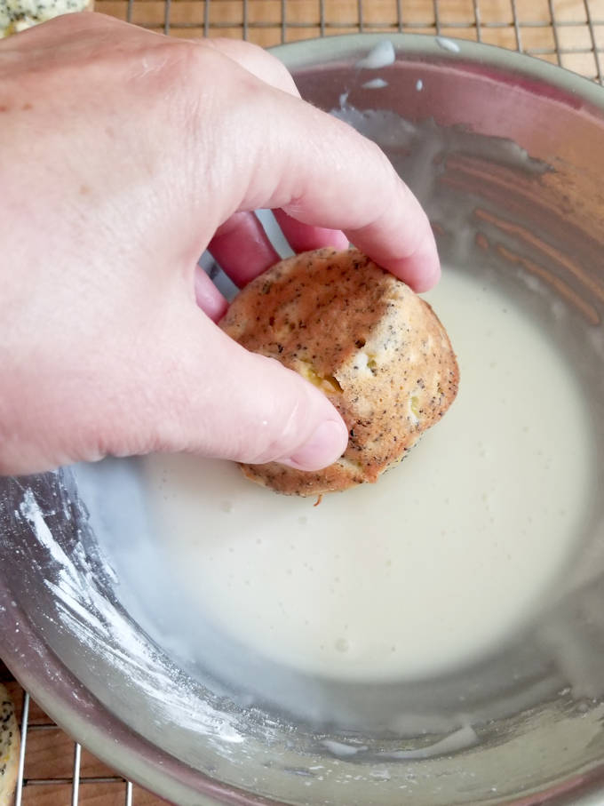 glazing a lemon poppy seed squash muffin