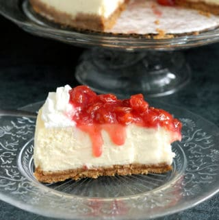 a slice of New York Cheesecake with sour cherry topping