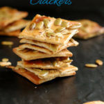 a pinterest image for pumpkin seed crackers with text overlay