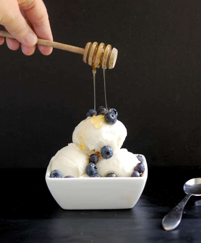 honey drizzled over a bowl of frozen yogurt
