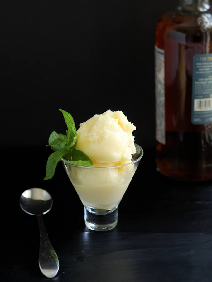 a glass filled with homemade pineapple rum sorbet