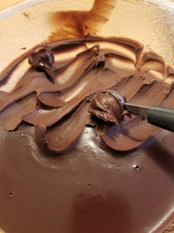 scooping ganache for chocolate truffles
