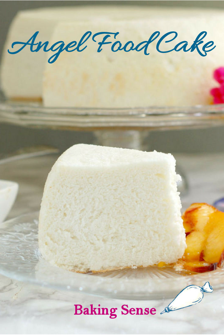 A slice of angel food cake on a glass plate with a full cake in the background. Blue text overlay says Angel Food Cake