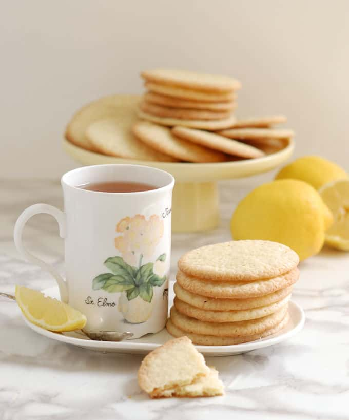 lemon thin cookies and a cup of tea on a table