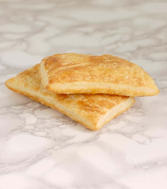 two pieces of baked classic puff pastry