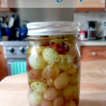 a jar of Pickled Grapes with text overlay for pinterest